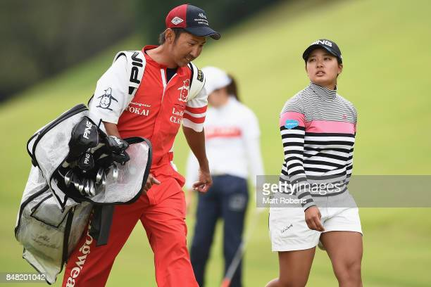 Ai Suzuki of Japan speaks with her caddie during the final round of the Munsingwear Ladies Tokai Classic 2017 at the Shin Minami Aichi Country Club...