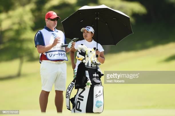 Ai Suzuki of Japan speaks with her caddie during the first round of the Resorttust Ladies at Kansai Golf Club on May 25 2018 in Miki Hyogo Japan