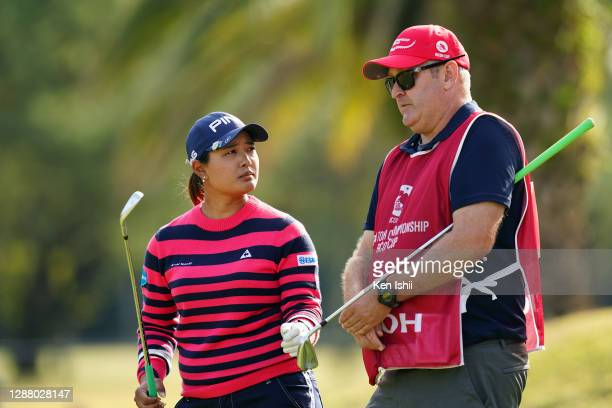 Ai Suzuki of Japan talks with her caddie on the 16th hole during the second round of the JLPGA Tour Championship Ricoh Cup at the Miyazaki Country...