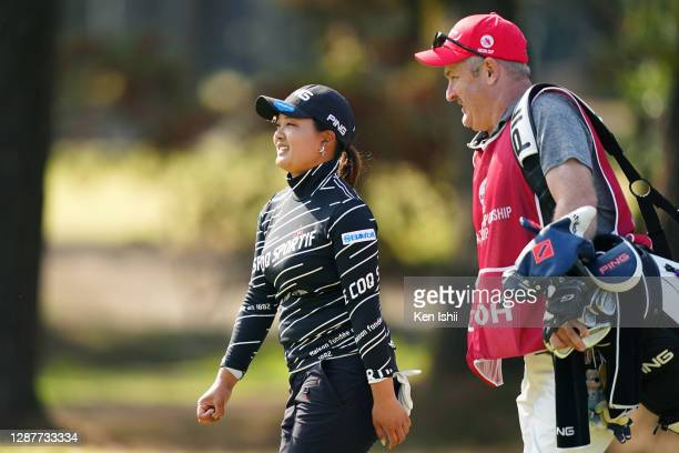 Ai Suzuki of Japan talks with her caddie on the 5th hole during the first round of the JLPGA Tour Championship Ricoh Cup at the Miyazaki Country Club...