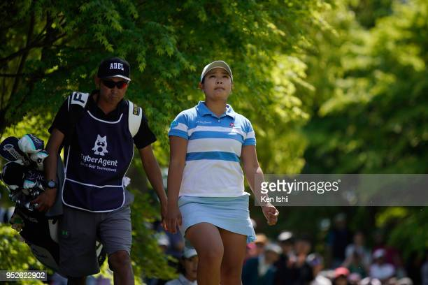 Ai Suzuki of Japan walks on the second hole during the final round of the CyberAgent Ladies Golf Tournament at Grand fields Country Club on April 29...