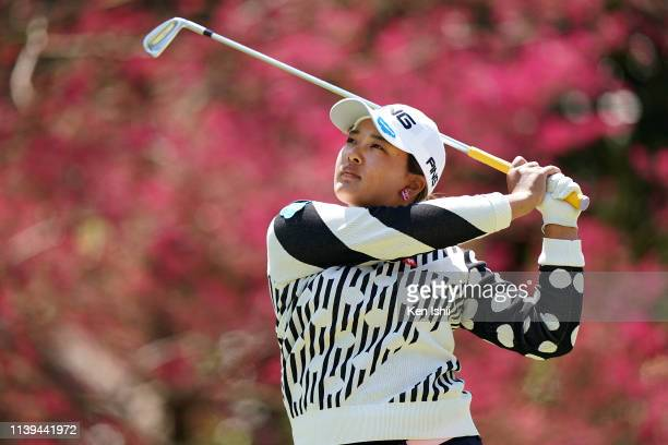 Ai Suzuki of Japan watches her tee shot on the sixteenth hole during the final round of the AXA Ladies Golf Tournament at the UMK Country Club on...