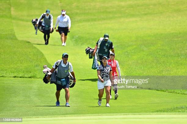 Ai Suzuki Reika Usui and Miki Sakai of Japan walk to the 4th green during the final round of the Earth Mondamin Cup at the Camellia Hills Country...