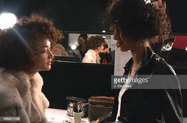 Ai Tominaga and Ujjwala Raut during Olympus Fashion Week Fall 2004 Reem Acra Front Row and Backstage at The Atelier at Bryant Park in New York City...