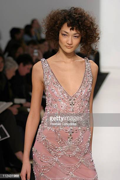 Ai Tominaga wearing Reem Acra Fall 2004 during Olympus Fashion Week Fall 2004 Reem Acra Runway at The Atelier at Bryant Park in New York City New...