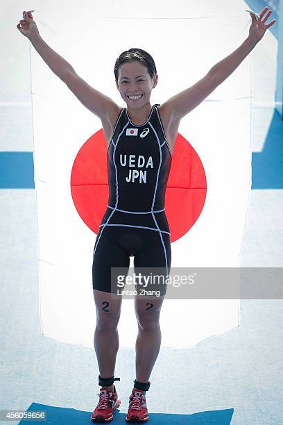Ai Ueda of Japan celebrates after crossing the finish line first during the Triathlon Women's Final in day six during the 2014 Asian Games at Songdo...
