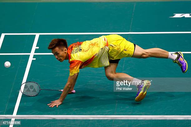Ai Wei Jian of Malaysia is at full stretch during his mens singles match against Kaizar Bobby Alexander of Indonesia during the 2015 Badminton Open...