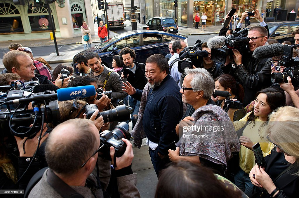 Ai Weiwei (L) and Anish Kapoor speak to the media as they depart the Royal Academy as they walk through the city as part of a march in solidarity with migrants currently crossing Europe on September 17, 2015 in London, England. Each artist carried a single blanket symbolizing the needs that face migrants coming to Europe.