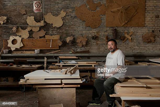 Ai Weiwei at the warehouse where he builds and stores his installations