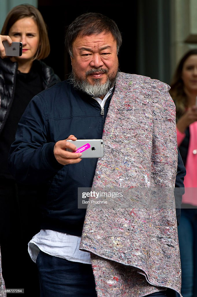 Ai Weiwei departs the Royal Academy as he walk through the city as part of a march in solidarity with migrants currently crossing Europe on September 17, 2015 in London, England. Each artist carried a single blanket symbolizing the needs that face migrants coming to Europe.