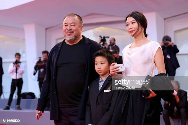 Ai Weiwei his wife Lu Qing and his son Lao Ai walk the red carpet ahead of the 'Human Flow' screening during the 74th Venice Film Festival at Sala...
