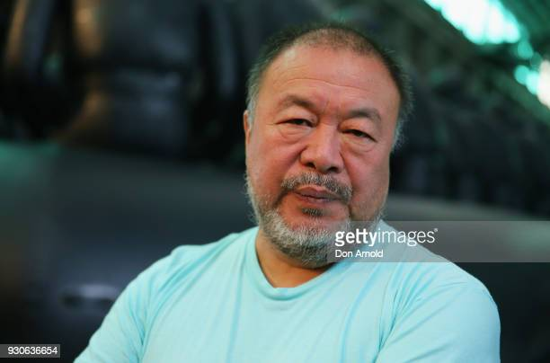 Ai Weiwei poses in front of his work 'Law of the Journey' on March 12 2018 in Sydney Australia The 60m rubber raft installation features over 300...