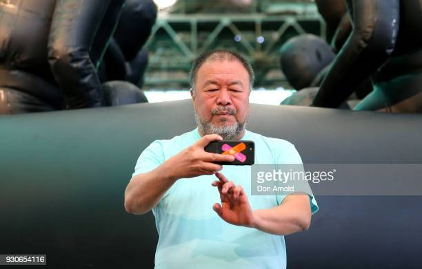 Ai Weiwei takes a selfie in front of his work 'Law of the Journey' on March 12 2018 in Sydney Australia The 60m rubber raft installation features...