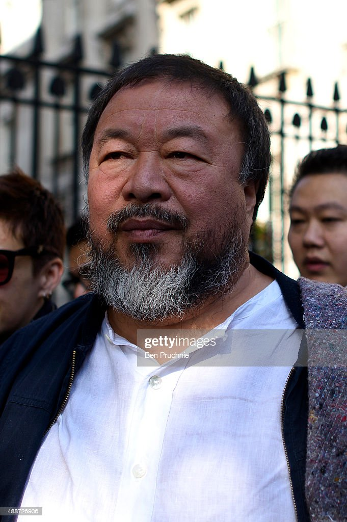 Ai Weiwei walks through the city as part of a march in solidarity with migrants currently crossing Europe on September 17, 2015 in London, England. Each artist carried a single blanket symbolizing the needs that face migrants coming to Europe.