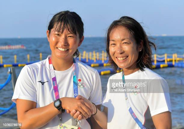 Ai Yoshida and Miho Yoshioka of Japan celebrate winning the gold medals in the Sailing Women's 470 on August 31 2018 in Jakarta Indonesia