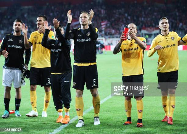 Aias Aosman Marco Hartmann and Patrick Ebert of Dynamo Dresden celebrate after victory in the Second Bundesliga match between SSV Jahn Regensburg and...