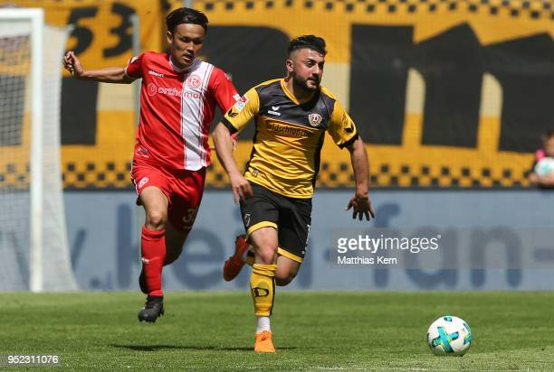 Aias Aosman of Dresden battles for the ball with Takashi Usami of Duesseldorf during the Second Bundesliga match between SG Dynamo Dresden and...