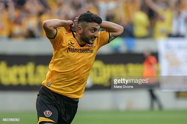 Aias Aosman of Dresden celebrates after decisive penalty during the DFB Cup match between Dynamo Dresden and RB Leipzig at DDVStadion on August 20...