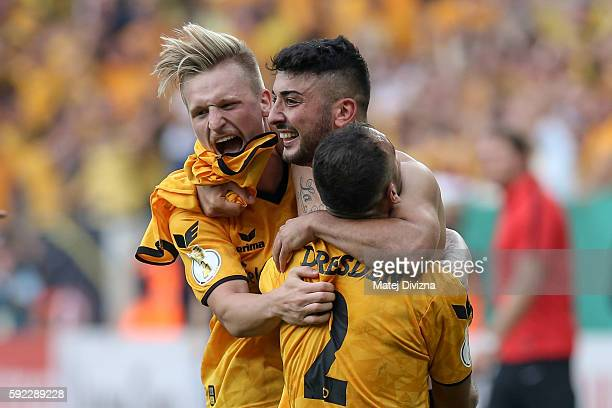 Aias Aosman of Dresden celebrates after decisive penalty with his team mates during the DFB Cup match between Dynamo Dresden and RB Leipzig at...