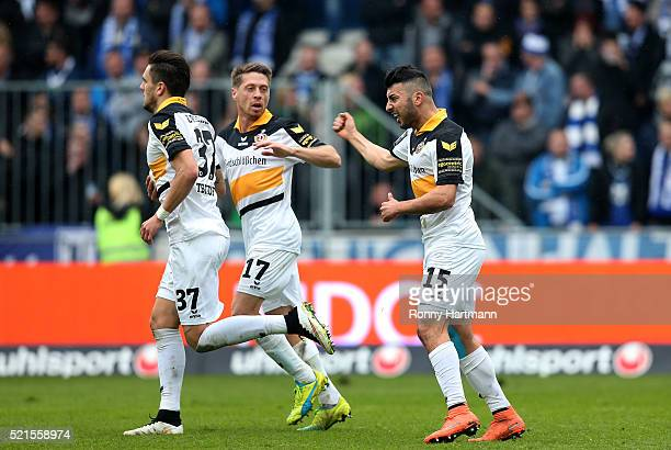 Aias Aosman of Dresden celebrates his team's first goal with Andreas Lambertz and Pascal Testroet of Dresden during the Third League match between 1...