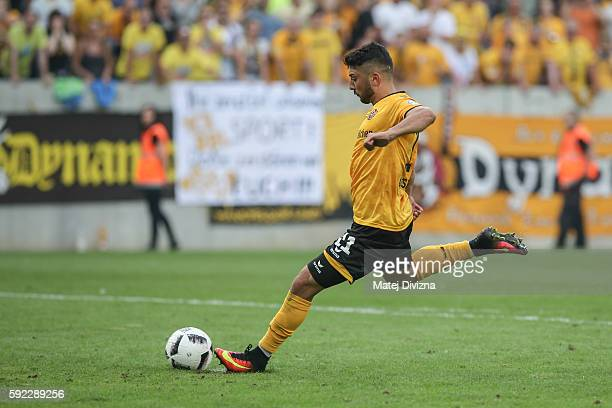 Aias Aosman of Dresden shots decisive penalty during the DFB Cup match between Dynamo Dresden and RB Leipzig at DDVStadion on August 20 2016 in...