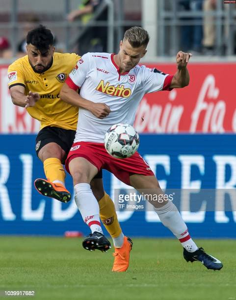 Aias Aosman of Dynamo Dresden and Benedikt Saller of Jahn Regensburg battle for the ball during the Second Bundesliga match between SSV Jahn...