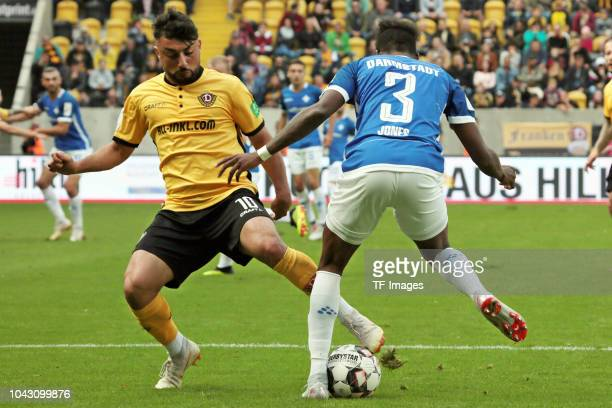 Aias Aosman of Dynamo Dresden and Jones Joevin of SV Darmstadt battle for the ball during the Second Bundesliga match between SG Dynamo Dresden and...