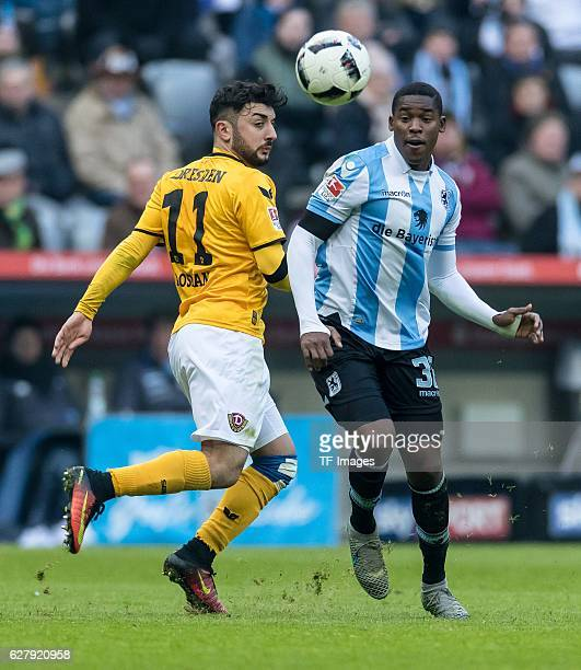 Aias Aosman of Dynamo Dresden and Romuald Lacazette of TSV 1860 Muenchen battle for the ball during the Second Bandesliga match between TSV 1860...