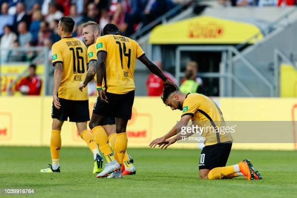 Aias Aosman of Dynamo Dresden celebrates after scoring his team`s first goal with team mates during the Second Bundesliga match between SSV Jahn...