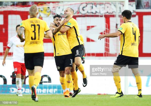 Aias Aosman of Dynamo Dresden is congratulated by Rico Benatelli of Dynamo Dresden after scoring the first goal during the Second Bundesliga match...