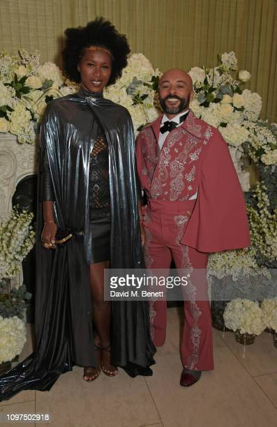 Aicha McKenzie and guest attend the British Vogue and Tiffany Co Celebrate Fashion and Film Party at Annabel's on February 10 2019 in London England