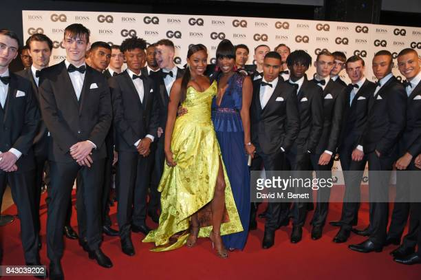 Aicha Mckenzie and Vanessa Kingori pose with models at the GQ Men Of The Year Awards at the Tate Modern on September 5 2017 in London England