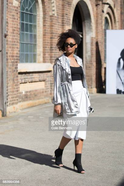 Aicha Robertson wearing Misguided jacket Tony Maticevski skirt Celibe Sunglasses and Skagen handbag during MercedesBenz Fashion Week Resort 18...