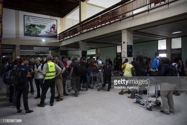 Aid volunteers arrive at Beira Airport after Cyclone Idai hit the area on March 24, 2019.