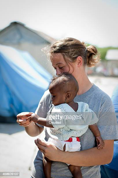 Aid worker with baby