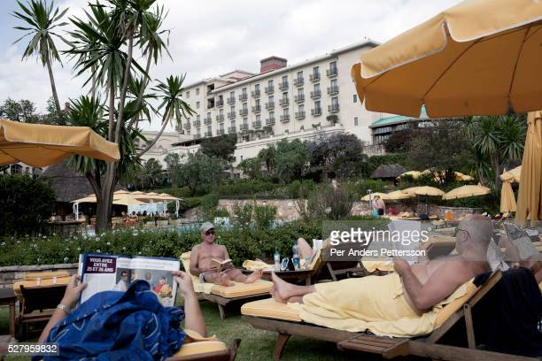 Aid workers and Expatriates enjoy the pool at Sheraton Hotel on a hot day on November 7 2010 in central Addis Ababa Ethiopia The hotel is one of the...