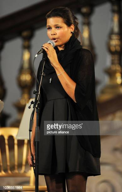 Aida Boehm sings at the memorial service of her father Karlheinz Boehm in Salzburg Germany 13 June 2014 The actor and founder of the Ethopia aid...
