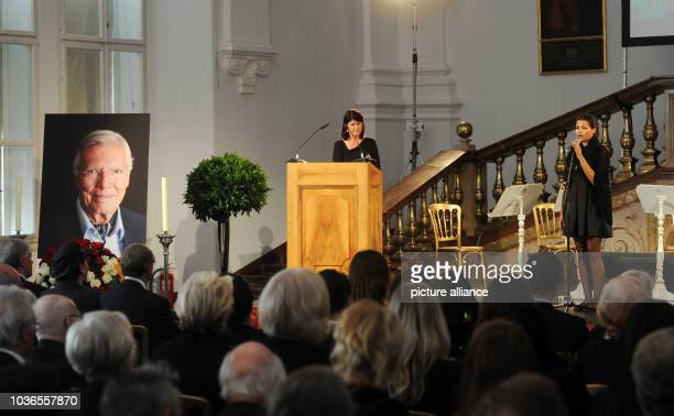 Aida Boehm sings at the memorial service of her father Karlheinz Boehm while the former governor Gabi Burgstaller stands at the speaker's desk in...