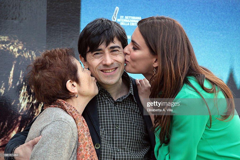 Aida Burruano, Luigi Lo Cascio and Catrinel Marlon attend 'La Citta Ideale' photocall at Casa del Cinema on April 9, 2013 in Rome, Italy.