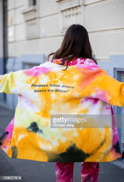Aida Domenech is seen wearing pants and top with batik print, yellow bag and jacket outside MSGM during Milan Fashion Week Fall/Winter 2020-2021 on...