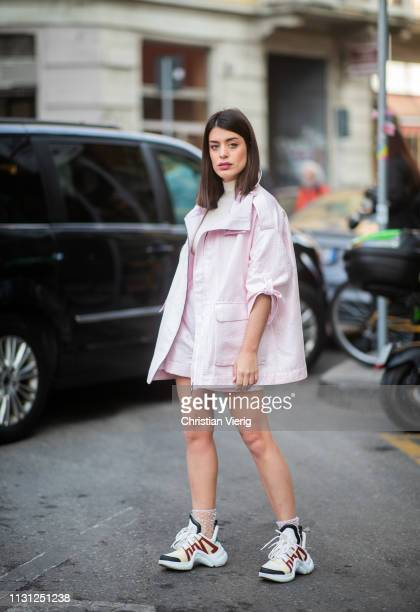 Aida Domenech is seen wearing pink jacket outside Armani on Day 2 Milan Fashion Week Autumn/Winter 2019/20 on February 21 2019 in Milan Italy