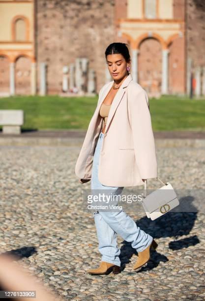 Aida Domenech seen wearing ripped denim jeans Dior bag blazer outside Alberta Ferretti during the Milan Women's Fashion Week on September 23 2020 in...