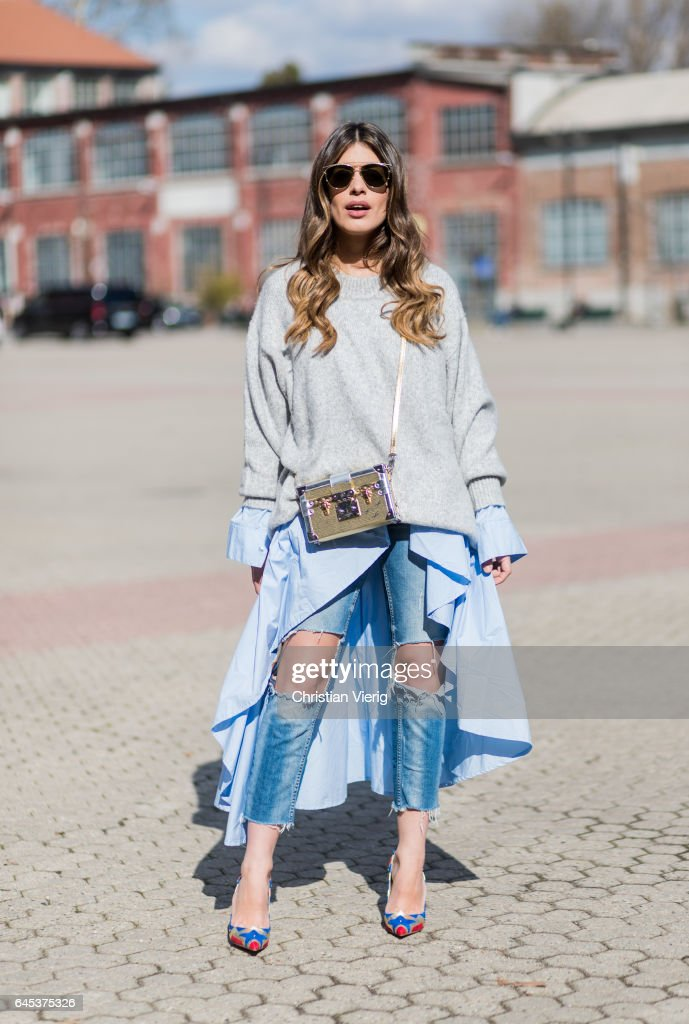 Aida Domenech wearing a grey knit, ripped denim jeans outside Missoni during Milan Fashion Week Fall/Winter 2017/18 on February 25, 2017 in Milan, Italy.