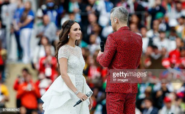 Aida Garifullina and Robbie Williams perform prior to the 2018 FIFA World Cup Russia group A match between Russia and Saudi Arabia at Luzhniki...