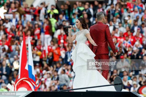 Aida Garifullina sings and Robbie Williams looks on during the 2018 FIFA World Cup Russia group A match between Russia and Saudi Arabia at Luzhniki...