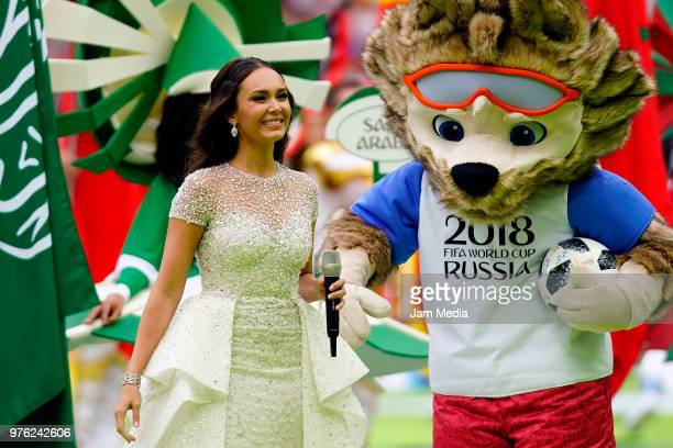 Aida Garifullina smiles with Mascot Zavibaka during the 2018 FIFA World Cup Russia opening ceremony prior to group A match between Russia and Saudi...