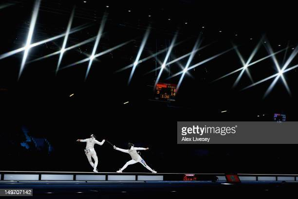 Aida Shanaeva of Russia and Elisa Di Francisca of Italy of Italy compete during the Women's Foil Team Fencing gold medal match on Day 6 of the London...