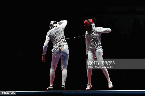 Aida Shanaeva of Russia and Ines Boubakri of Tunisia compete during the women's individual foil bronze medal bout on Day 5 of the Rio 2016 Olympic...