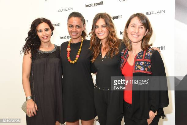 Aida Touihri Laurence RoustandjeeLaetitia Millot and Alexia Laroche Joubert attend Le Coq Sportif x Guerlain Photocall At the Le Coq Sportif Flagship...