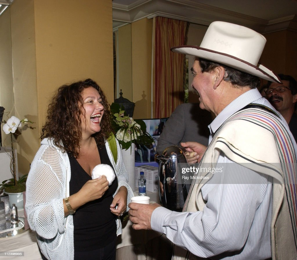 Aida Turturro and 'Juan Valdez' during The HBO Luxury Lounge at the 56th Annual Emmy Awards at The Peninsula Hotel in Beverly Hills, California, United States.